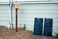The speaker box was designed for attendees to talk about what they wanted to see in the neighborhood. The boards invited neighbors to write what they wanted to give and find in the neighborhood.